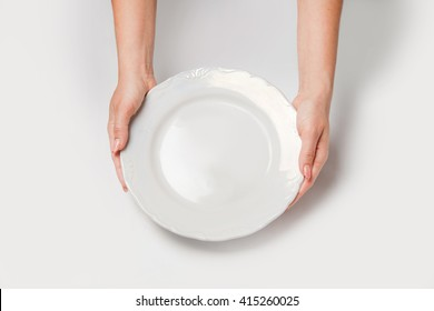 Woman two hands hold a white dish(plate) isolated white