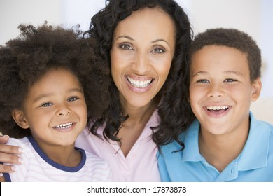 Woman and two young children smiling