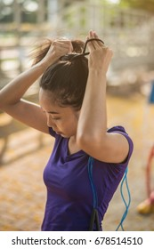 Woman tying hair getting ready for workout