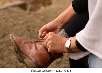 Woman tying her boots