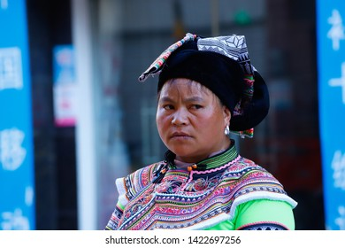 A woman in typical clothes in a village in southern Yunnan, China. Yunnan, China - November, 2018