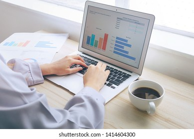 Woman is typing data on laptop on the morning, working concept.
