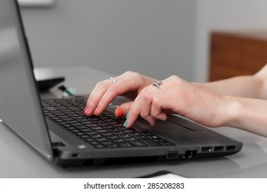woman typing on the computer