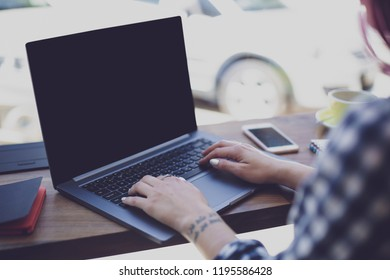 Woman typing on notebook with blank screen with copy space for y