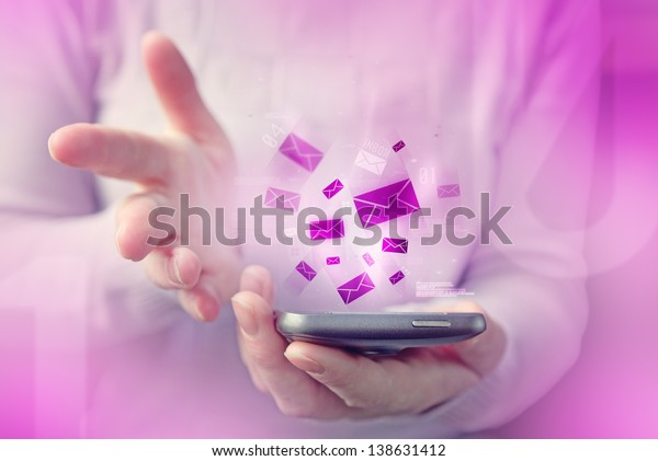 Woman typing text message on smartphone, close up image with focus on phone device and e-mail inbox envelopes.