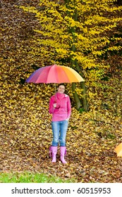 woman with an umbrella in autumnal nature