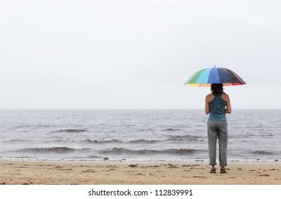 A woman with an umbrella, Halland, Sweden.