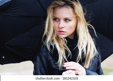Woman with umbrella in rainy weather