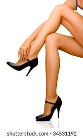 The woman unbuttons patent-leather shoes