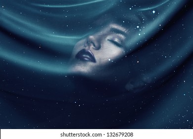 woman under transparent textile with stars