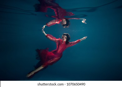 woman under water in different poses