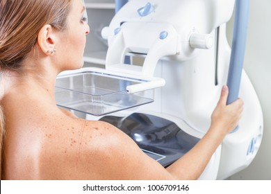 Woman undergoing medical mammography scan.