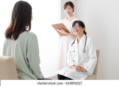 Woman undergoing pregnancy medical examination, rejoice, doctor, female doctor, nurse