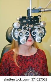 Woman undergoing refractive eye exam.
