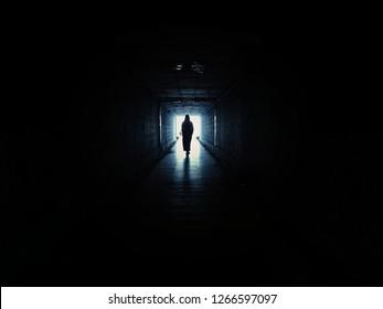 woman in underground dark corridor