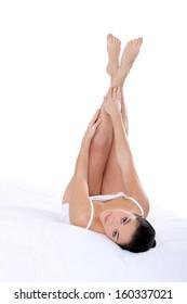 woman in underwear with legs raised