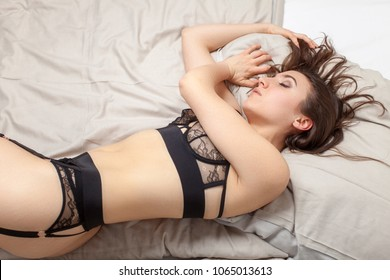 woman in underwear sleeping in a bed