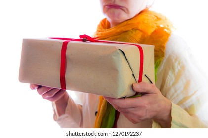 a woman is unhappy with a gift package
