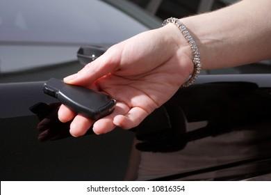 A woman unlocking her car wearing a diamond tennis bracelet