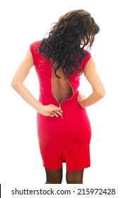 Woman unzips her red dress. Isolated on white.