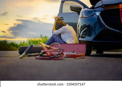 Woman upset waiting for help and assistant at dark of the night, scary and worry alone in the dark, car engine failure or tire need replacement