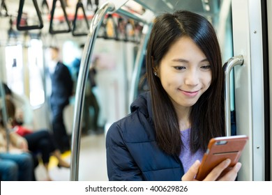 Woman use of cellphone inside train compartment