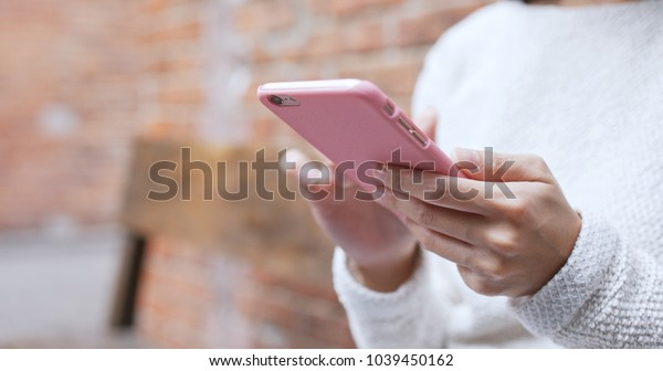 Woman use of cellphone at outdoor