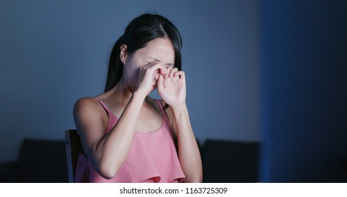 Woman use of laptop computer and feeling dry of eye