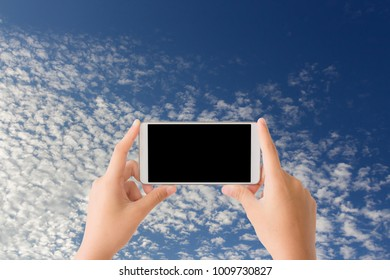 woman use mobile phone and altocumulus clouds with blue sky as background