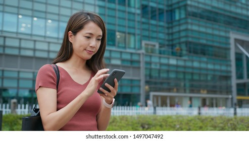 Woman use of mobile phone with business background