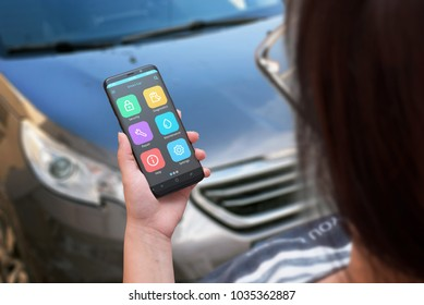 Woman use mobile phone to find information about car maintenance.
