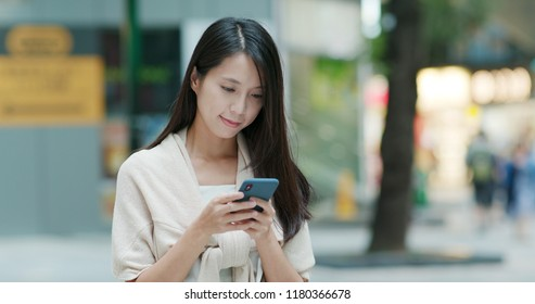 Woman use of mobile phone for sending sms