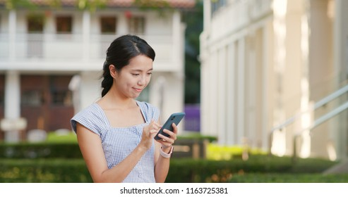 Woman use of mobile phone at the street