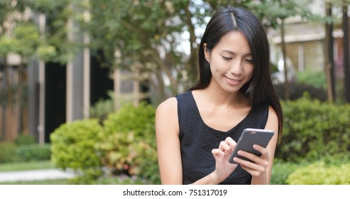 Woman use of mobile phone in the street