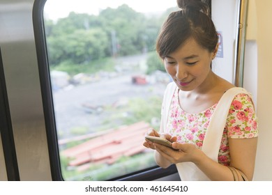 Woman use of mobile phone in underground subway station