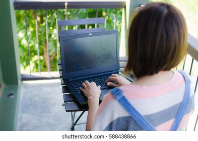 woman use notebook at the park