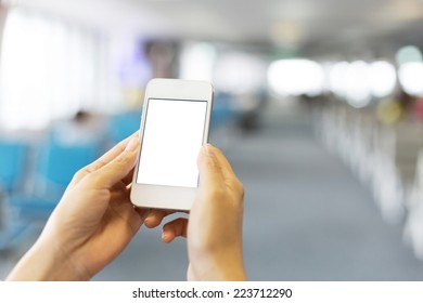 woman use smart phone in airport in airport
