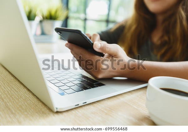 woman use smartphone on desk in office place