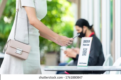 Woman use smartphone scan qr code for entering restaurant for application track and trace customer
