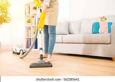 Woman use vacuum cleaner to cleaning the floor in living room. Housework concept. mixed race asian chinese model.