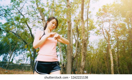 woman use wearable smart watch in the forest