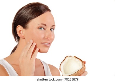 Woman uses coconut cream for her face