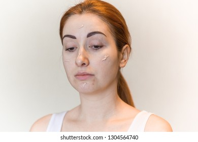 Woman uses concealer on face, acne skin problem, face make up covered and Concept of skin problems