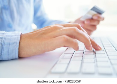 Woman uses a credit card for online payments. The concept of online shopping
