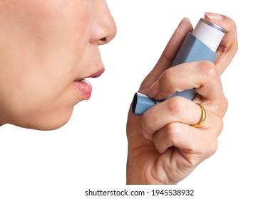 Woman uses an inhaler during an asthma attack, close-up - Shutterstock ID 1945538932