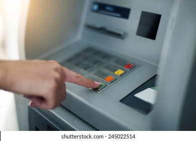 Woman using banking machine. Close up