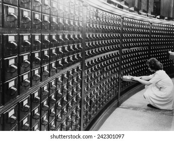 Woman using the card catalog at the Main Reading Room of the Library of Congress, ca. 1940.