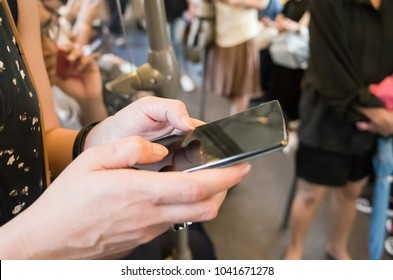 woman using cellphone, closeup image