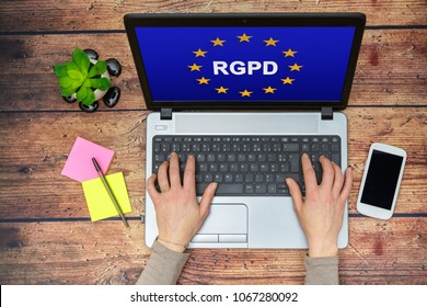 Woman using a computer with Flag of European Union with RGPD word inside on the screen