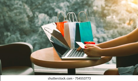 Woman using credit card with shopping online concept at cafe.